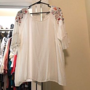 White blouse with embroidery on the sleeves